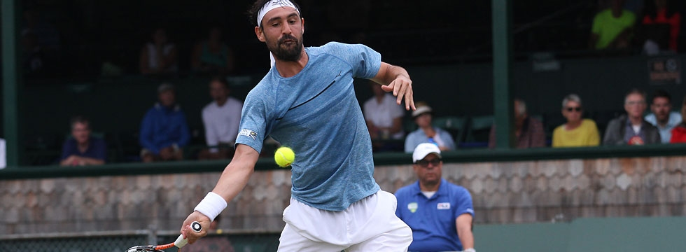Marcos Fights Past Sela In Newport QF